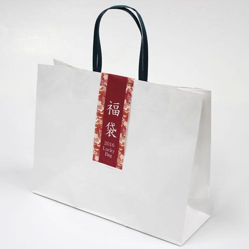 オリジナルの福袋ラベルと無地の紙袋で福袋パッケージ。